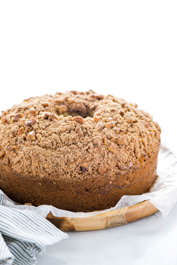 baked Gluten Free Sour Cream Coffee Cake Recipe ready to serve on a wax paper lined wood platter