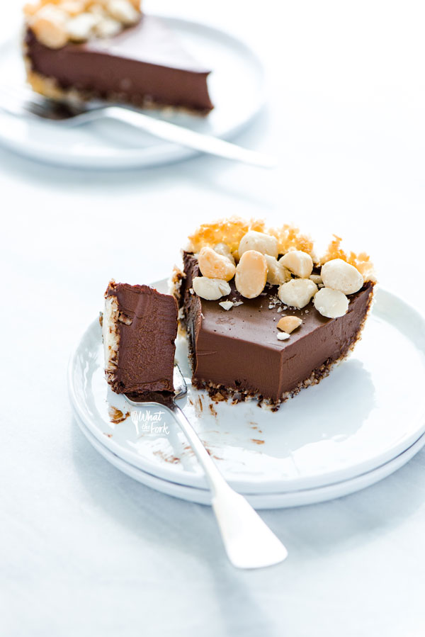 a slice of Macadamia Nut Chocolate Pie with Coconut Crust with a bite on a fork