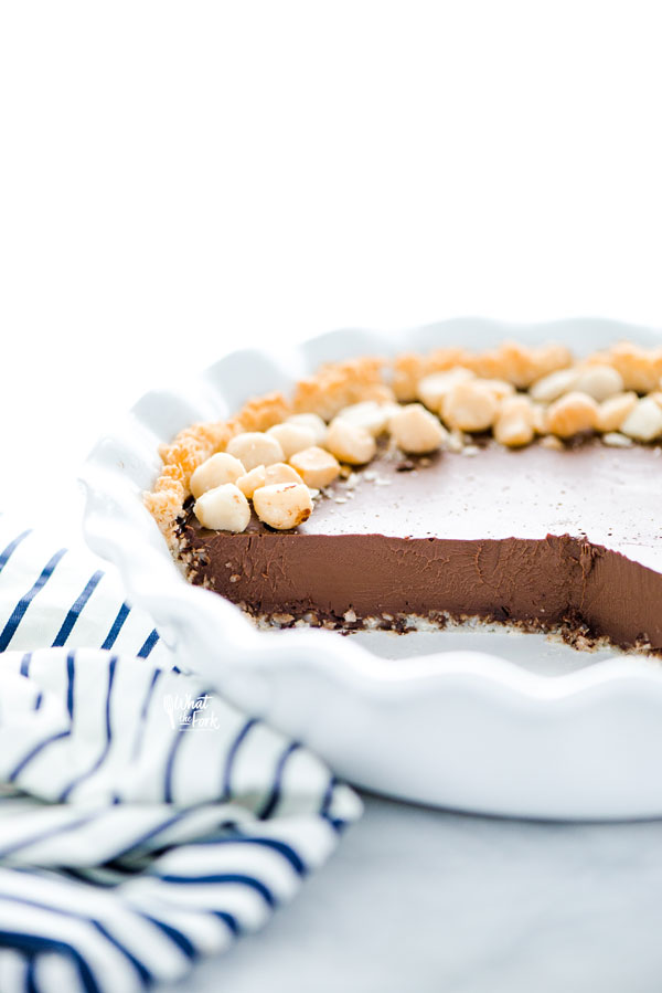 a Macadamia Nut Chocolate Pie with Coconut Crust that's been sliced into