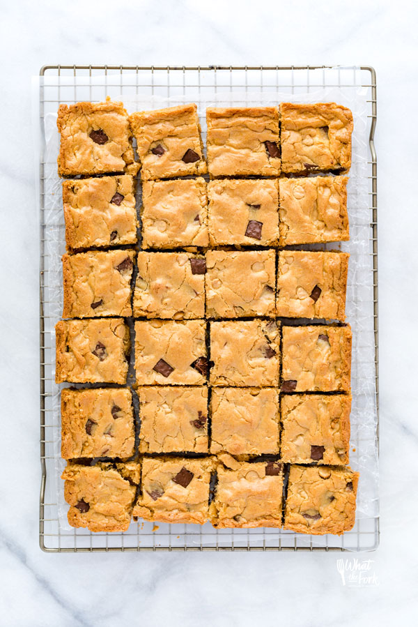 overhead shot of gluten free blondies on a wax paper lined metal cooling rack