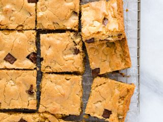 overhead shot of gluten free blondies on a wax paper lined cooling rack
