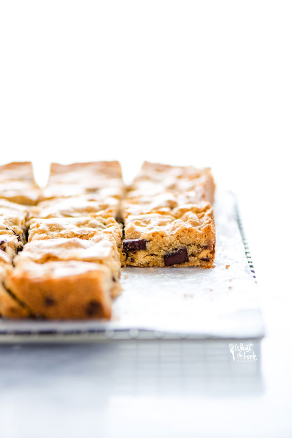 straight on shot of gluten free blondies on a wax paper lined cooling rack