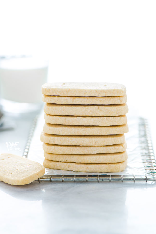 a stack of Gluten Free Shortbread Cookies on a small metal wire rack lined with wax paper